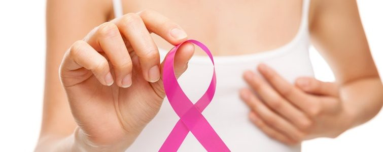 Woman with a pink breast cancer awareness ribbon